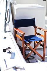 wooden chair on modern yacht