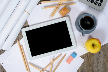 Digital tablet with a coffee and an apple on the desk