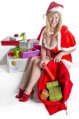 Female Santa with Christmas presents and sack