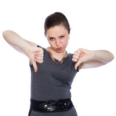 Young woman showing thumbs down