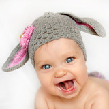 smiling baby like a bunny or lamb