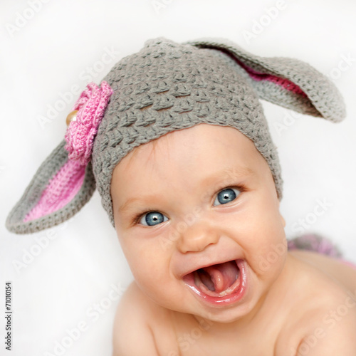 smiling baby like a bunny or lamb - 71010154