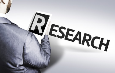 Business man with the text Research in a concept image