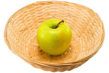 green apple in a basket on a white background