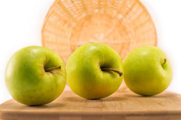 green apples lying on a cutting board