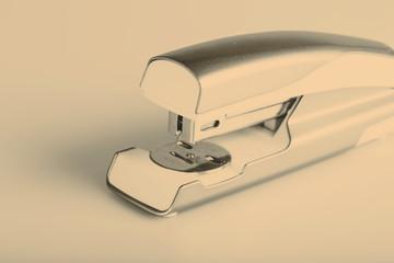 Light green stapler isolated on white