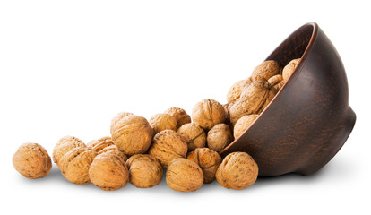 Walnuts Spill Out Of A Clay Bowl