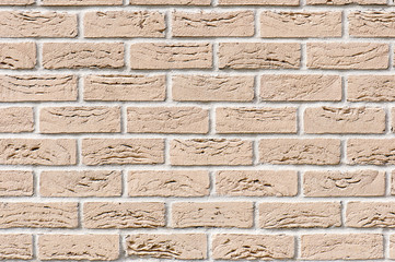 Ocher brick wall for background or texture