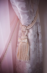 curtain hold back by tassel