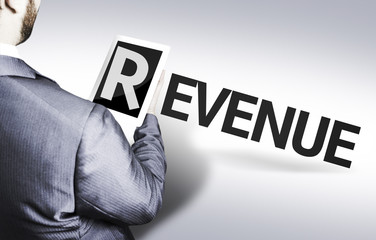 Business man with the text Revenue in a concept image