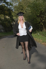 Mature university student in cap and gown