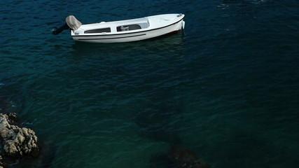 Fishing boat afloat in the Mediterranean Sea. Croatia shore.