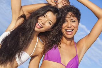 Two Beautiful Women In Bikinis Dancing on Sunny Beach