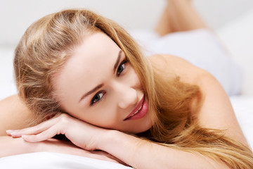Beautiful girl lying on the bed