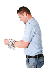 Businessman tied up with chain