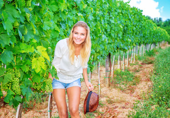 Happy woman on vineyard