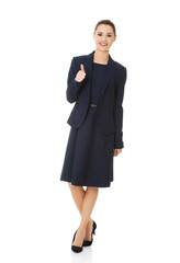 Happy business woman with ok hand sign