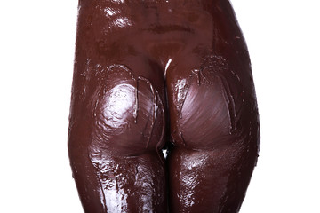 Naked female body covered with chocolate