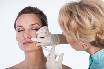 Doctor making a mouth botox