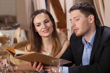 Young couple choosing from menu