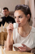 Elegant woman drinking coffee
