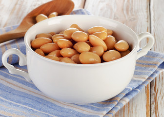White beans on a wooden table