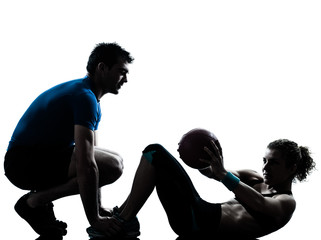 man woman exercising weights workout fitness ball silhouette