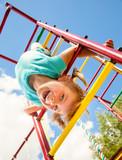 Happy child on a jungle gym - 71025719