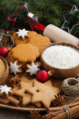 Assorted Christmas cookies and ingredients for baking, vertical
