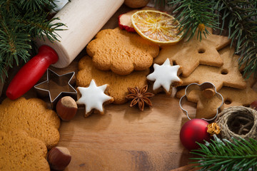 Assorted Christmas cookies, decorations, spices on wooden board