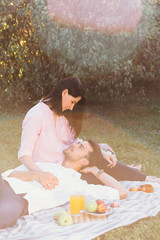 Pregnant couple on picnic