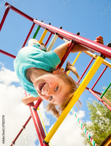 Happy child on a jungle gym - 71025719