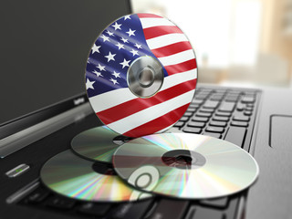 Software made in USA CD on laptop keyboard. Compact disks.