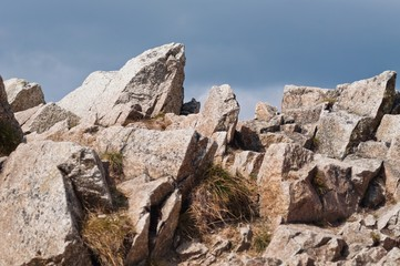 Stones in high mountain with blue sky