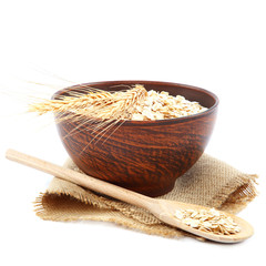 Oatmeal flakes in wooden bowl. Healthy food.