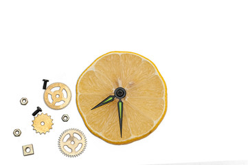 Isolated composition with lemon and clock work parts