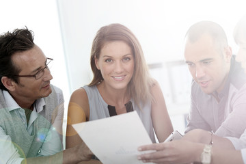 Smiling blond businesswoman sitting in a meeting