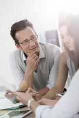 Mature businessman attending work meeting