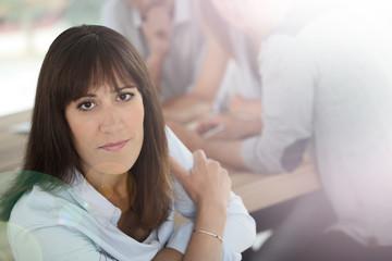 Portrait of brunette girl in office