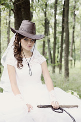 portrait bride in a cowboy hat, tinted