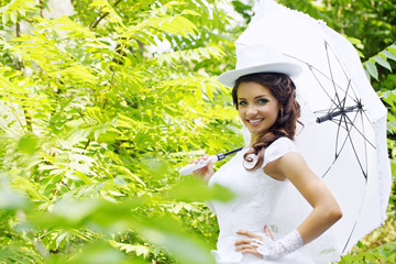 Bride holding umbrella