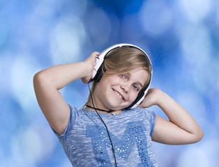 Current clothing girl with headphones listening to music