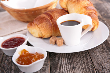 breakfast with coffee cup, croissant and jam