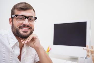 Casual designer smiling at camera