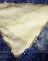 Blue torn jeans and fabric texture