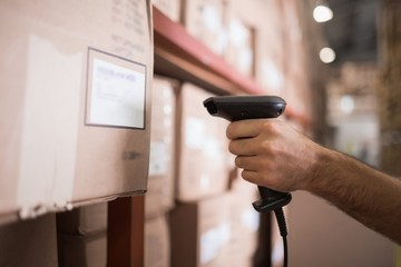 Close up of worker holding scanner in warehouse