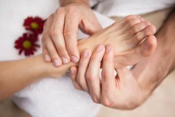 Pedicurist massaging a customers foot
