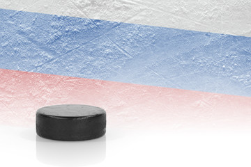 Hockey puck and a Russian flag