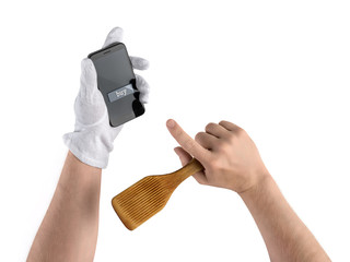 chef hands with kitchen spatula and smartphone, purchase in the