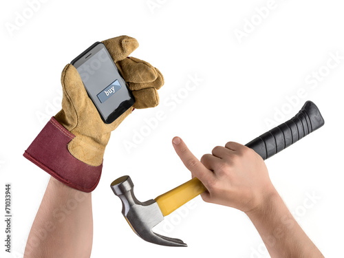 hand construction worker with hammer and smartphone, purchase in - 71033944